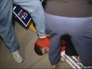 Political activist being stomped upon