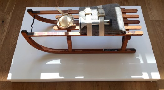 Schlitten, 1969 - Wooden sled, felt, belts, flashlight, fat, rope, and oil paint (brown cross) 36 x 17 x 13 1/2 in (91.4 x 43.2 x 34.3 cm) stamp numbered `04' on a plaque affixed to the sled (the edition was 50 and 5 hors commerce), published by Galerie René Block, Berlin. Estimate 150-250 TUSD