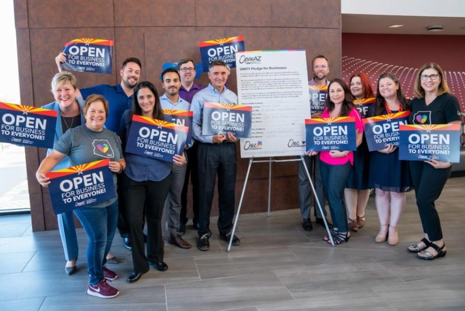 Photo of SRP employees celebrating the signing of the #OpenAZ UNITY Pledge