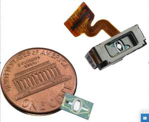 Optical Light Engine with a coin for size comparison