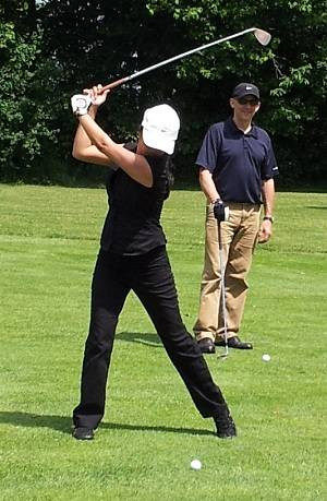 Joanne's perfect golf swing with caddie Rick looking on