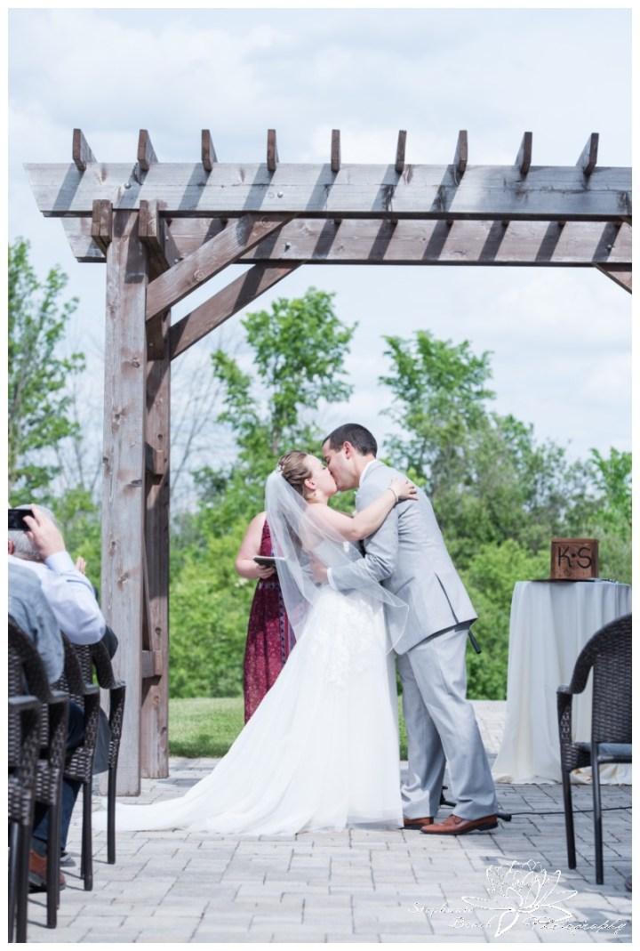 Gatineau-Golf-Club-Wedding-Stephanie-Beach-Photography-ceremony-first-kiss-bride-groom