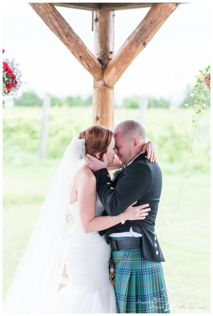 Jabulani-Vineyard-Wedding-Stephanie-Beach-Photography-ceremony-first-kiss-bride-groom