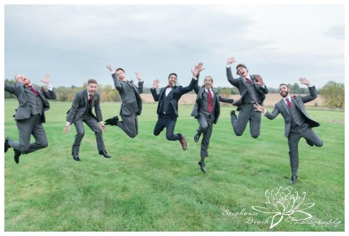 Strathmere-Lodge-Wedding-Stephanie-Beach-Photography-groom-groomsmen-jumping-portrait