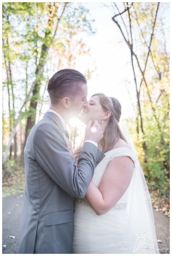 Ottawa-Fall-Wedding-Stephanie-Beach-Photography-bride-groom-sunflare-portrait-kiss