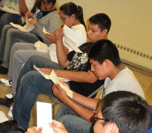 Lakota youth reading letters at St. Joseph's retreat