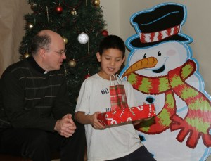 Fr. Steve and Trenton chat at St. Joseph's Indian School's Christmas store.
