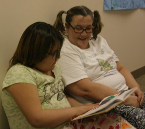 The Lakota students and their teachers took a break to read a Dr. Seuss story.