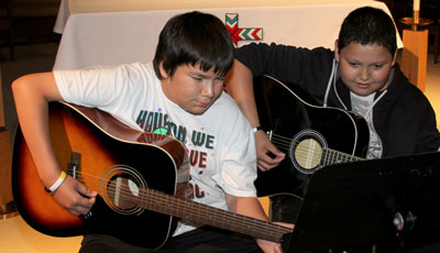 The Lakota children at St. Joseph's have the opportunity to take music lessons.