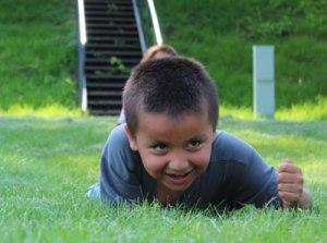 Lakota boy imitating snake