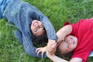 Two girls partner log roll