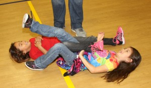 The Lakota students learned to leg wrestle during Native American Day activities.
