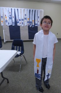 The students made stoles decorated with symbols relating to the sacraments and will wear them when they are baptized.