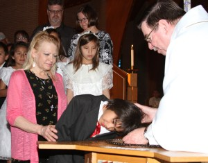 Twenty-one students at St. Joseph's were baptized with the support of their families.