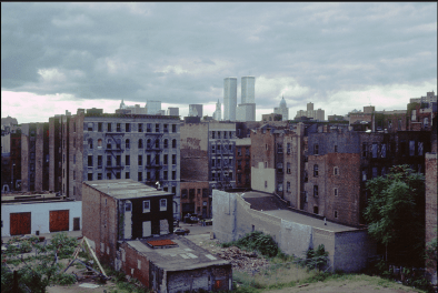 Photo: Abandoned Buildings with a View of the Twin Towers off in the Distance