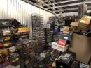 Storage unit auction, a large unit full of model cars, some unassembled in boxes, some in display cases