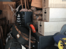 Online storage unit containing luxury household items and three large safes