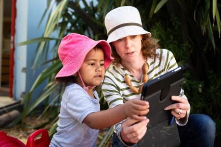 preschooler with educator