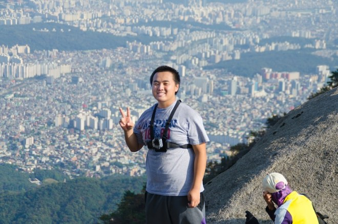 Mt. Bukhansan, the highest mountain in Seoul and standing at the highest peak of the mountain, which is Baegundae Peak.