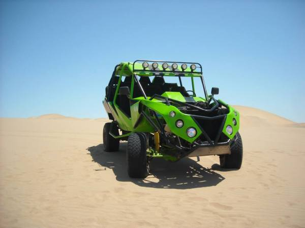 """Dune Buggy"" A trip to Ica, Peru isn't complete until you've barreled over the mountainous sand dunes in a neon green dune buggy!"