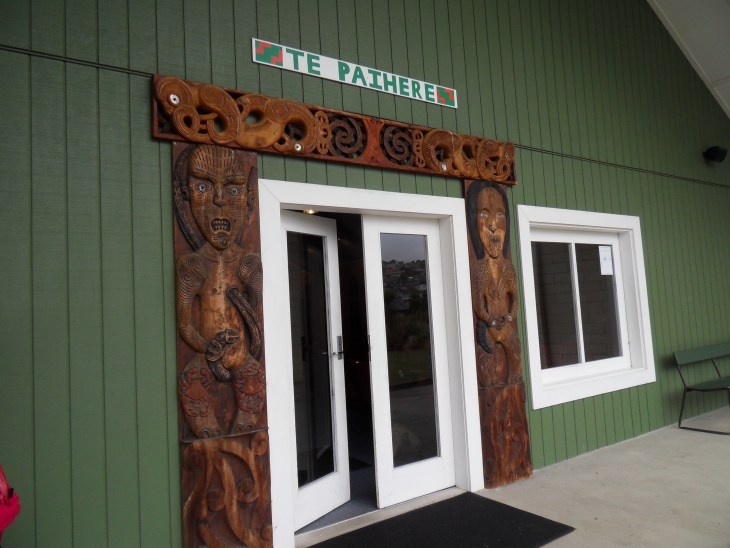 Entrance to the Araiteuru Marae in Dunedin, New Zealand featuring traditional Māori carvings