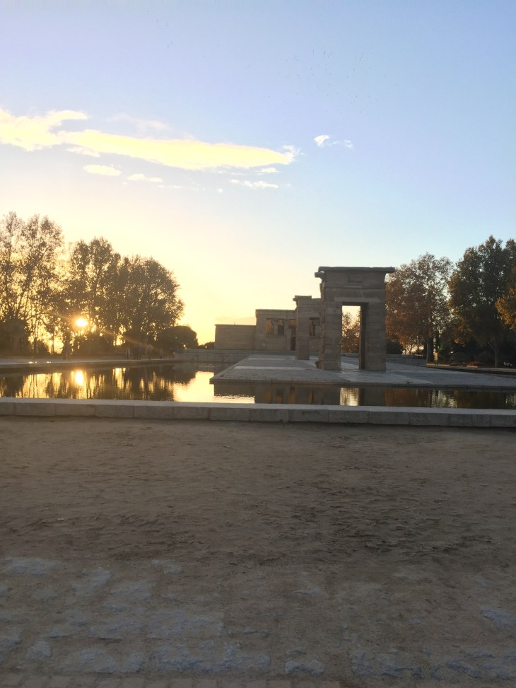 The view as the sun is setting behind the Debod Temple