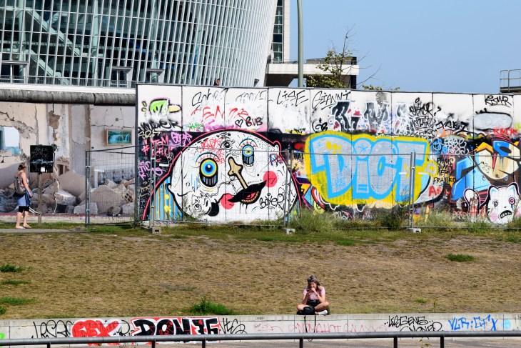 EastSideGallery_Berlin_Germany_JuliaBlueArm_Photo1.JPG