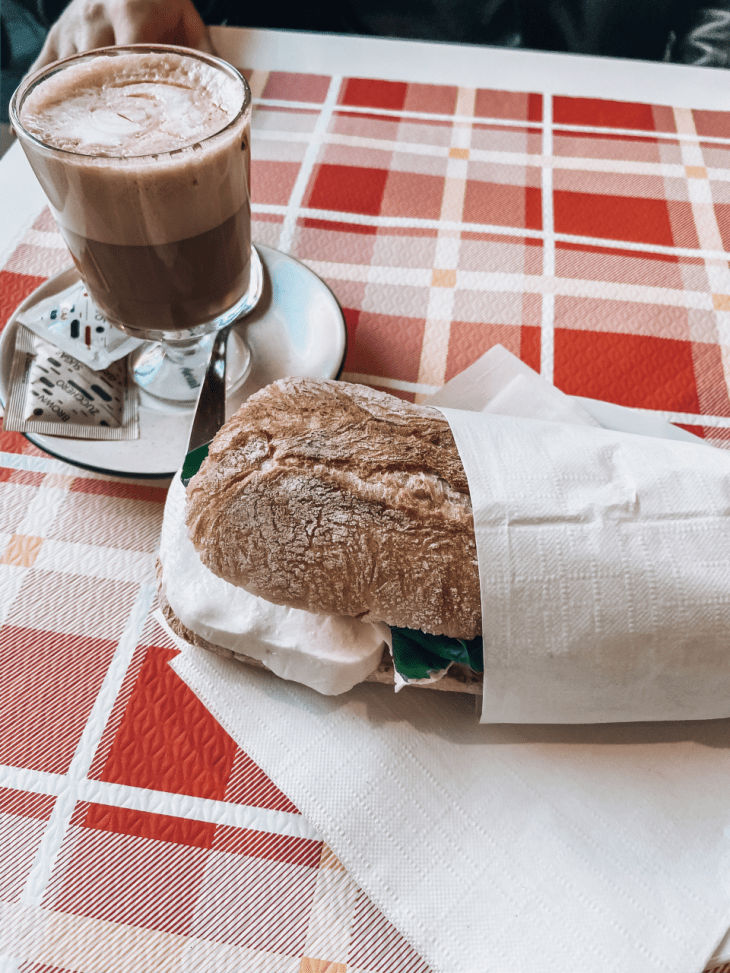 a sandwich and capuccino at cafe de amics