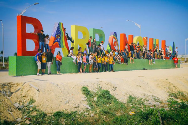 ISA students in front of the Barranquilla sign in Colombia.