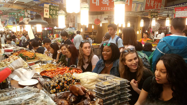 ISA students enjoying lunch at a Seoul market during an ISA Busan excursion.