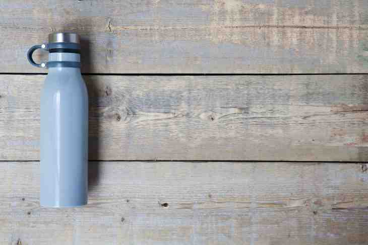 Reusable water bottle laying on wooden floor