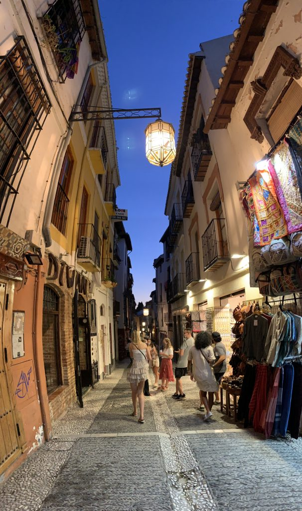 Girl walking down alley in evening