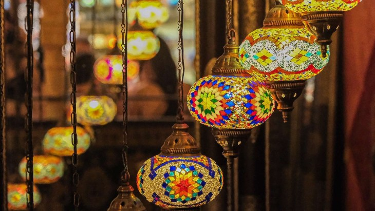 Moroccan-style lamps hanging in storefront in Albaicin district of Granada