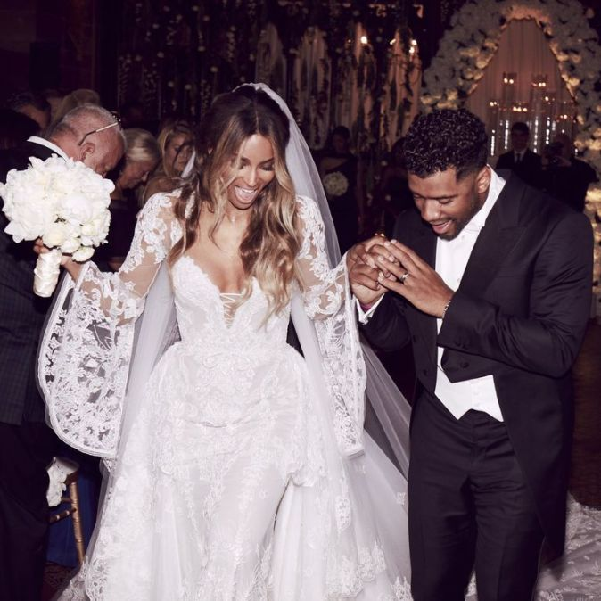 Ciara in a custom Roberto Cavalli lace wedding dress with sleeves
