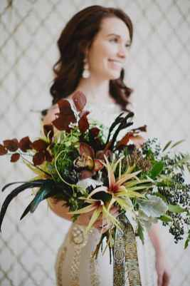 a bride with a burgundy bouquet for a winter wedding