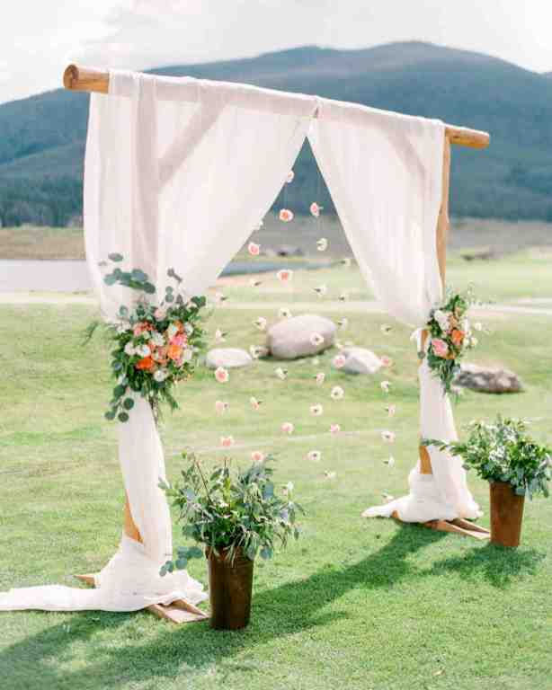 spring wedding inspiration and ideas curtain and flower backdrop for ceremony connie whitlock studio i do