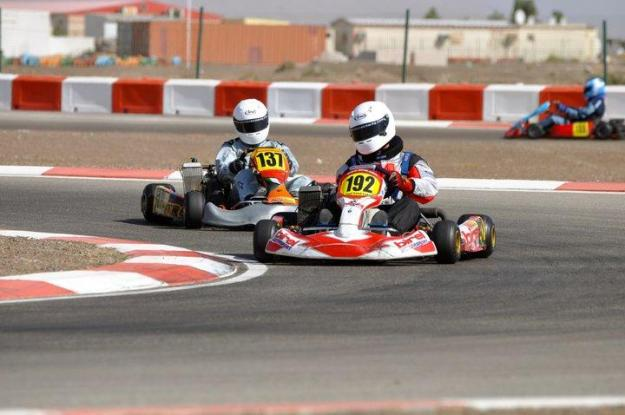 Luc (192) being pursued by senior Max racer Ali Al Najjar (137)