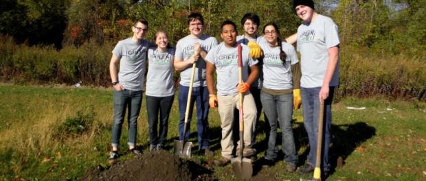 SUNY Ulster Environmental Club digging a hole