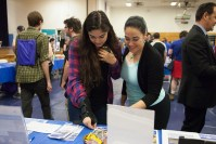 Prospective students looking at materials during Open House