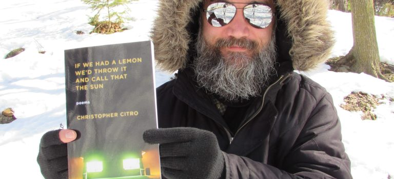Christopher holding If We Had a Lemon in the snow