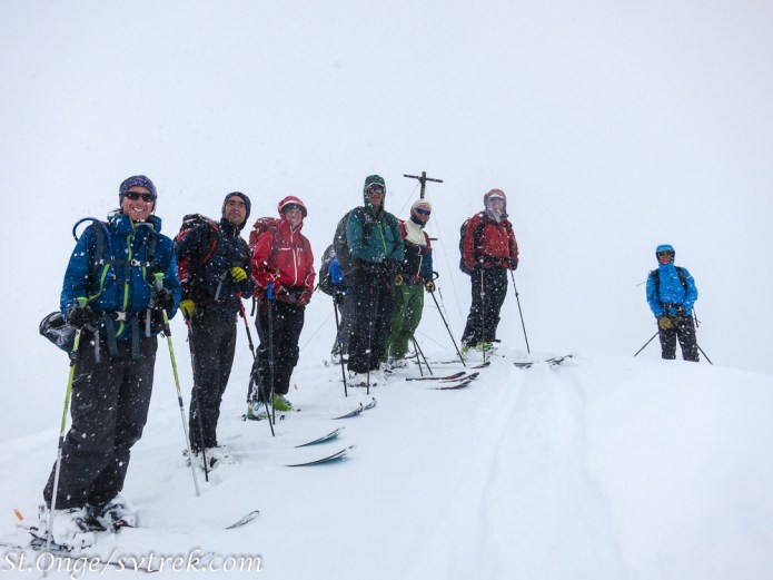 The team, on top of the mighty Tornak Peak in the storm