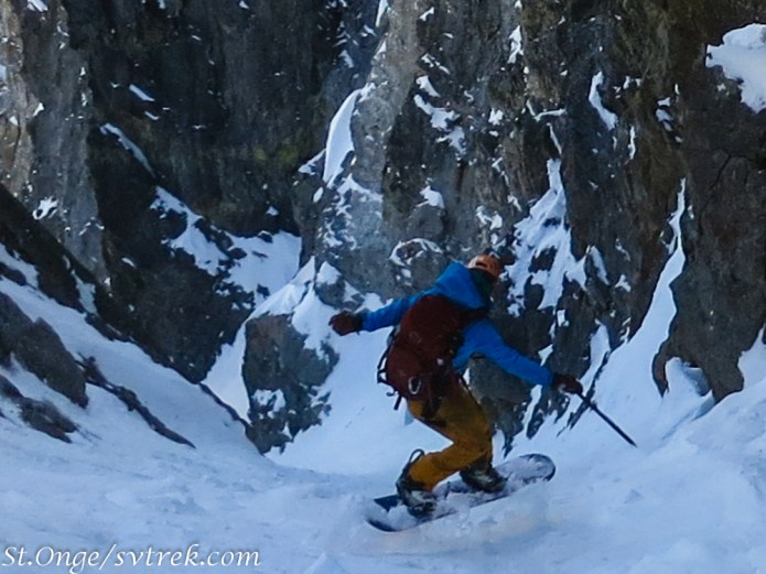 Chris, opening his wings while making a jump turn on the 50+ degree couloir