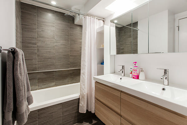 Quick Look Wood Finished Vanity And Gray Pencil Tile In A