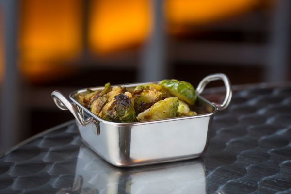 roasted brussel sprouts in stainless steel server