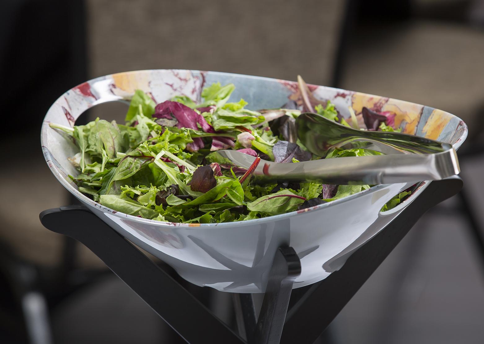 Tong in salad bowl