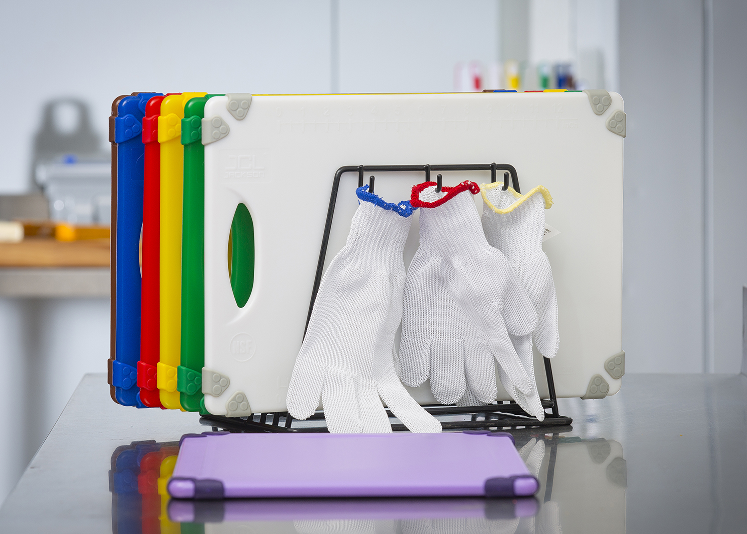 Cutting board racks in kitchen with gloves