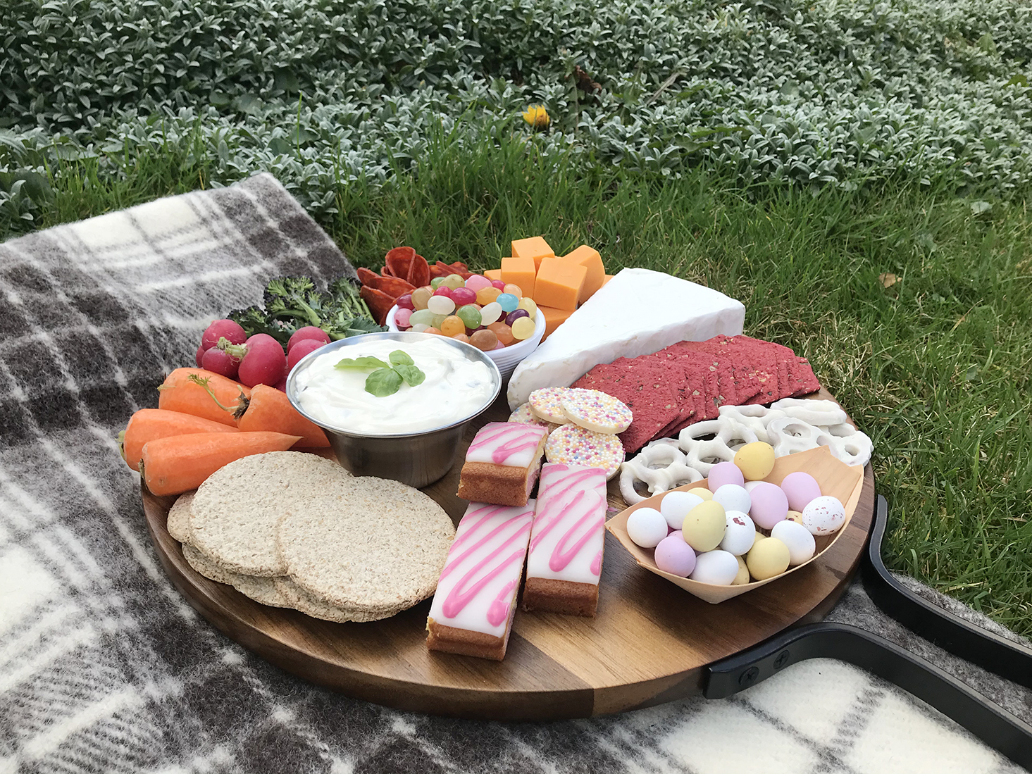 sweet and savory snacks on grazing board
