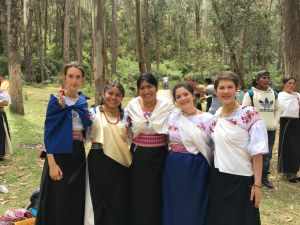 Jessica (center) and other TSC volunteers dressed in traditional Ecuadorian clothing for a celebration in Tangali on their last day in the community