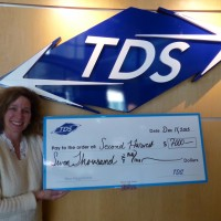 In Dec. 2013, Vicki Villacrez presented a check to Second  Harvest Foodbank of Southern Wisconsin on behalf of the  employees at TDS.