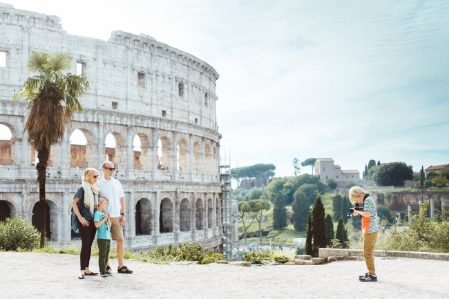 "With the Colosseum towering over them in the background, Adam tries his hand as photographer. ""I don't think the boys are little citizens because their passports have a new stamp. It's bigger than that. It's the conversations we have at home that matter."" says Leigh."